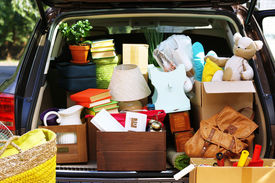 pic of heavy bag  - Moving boxes and suitcases in trunk of car - JPG