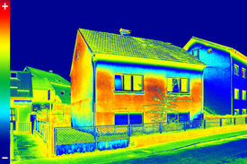 stock photo of thermal  - Infrared thermovision image showing lack of thermal insulation on House - JPG