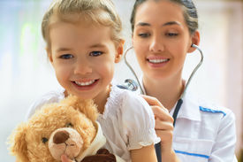 foto of hospital  - doctor examining a child in a hospital - JPG