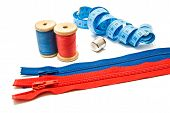 Two Zipper, Meter, Thimble And Spools Of Thread