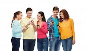friendship, technology and people concept - group of smiling teenagers with smartphones