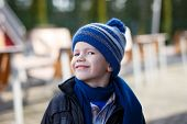 Little Boy In Winter Cap Smile Outdoor