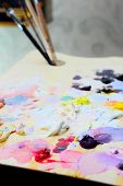 stock photo of paint palette  - art paint palette with brushes and colorful paints - JPG