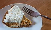 image of pumpkin pie  - Fork ready to dive into a piece of whipped pumpkin pie - JPG