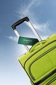Columbus, Ohio. Green Suitcase With Label