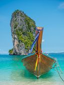 Long tail boat, Clear water and blue sky. Krabi province, Thailand.