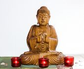 wooden carving of Lord Buddha welcoming
