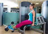 Calf extension woman at gym exercise machine workout indoor