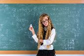 Clever nerd pupil blond girl in green board thinking student schoolgirl