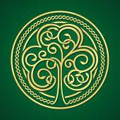 St. Patrick's day. Gold shamrock on a green background