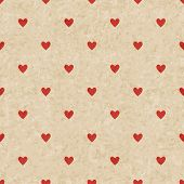 Abstract vintage heart pattern on grunge old paper texture Seamless hipster geometric background.