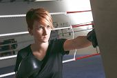 fitness woman doing punching exercises in training place