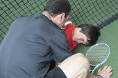boy tennis player who having a injury