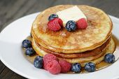 Classic pancakes with butter berrys and maple syrup