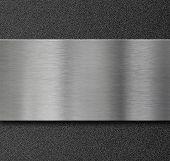 metal panel over black plastic plate
