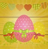 Easter Eggs And Bunting On Wooden Background
