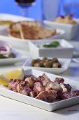 stock photo of sucker-fish  - greek octopus salad with a lemon on wood  - JPG