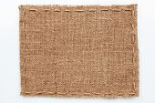 Frame Of Burlap  Lies On A White  Background