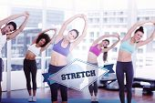 The word stretch and sporty women stretching hands at yoga class against badge