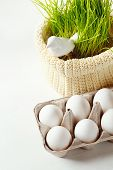 picture of grass bird  - Easter background with eggs in the box and cute bird in green grass at the back - JPG