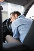 Drunk man slumped on steering wheel in his car