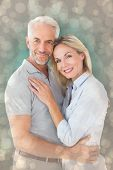 Happy couple standing and smiling at camera against light glowing dots design pattern