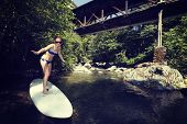 girl surfing on a surfboard, sunny day summertime