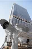 picture of cctv  - CCTV camera against skyscraper - JPG