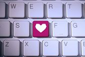 Heart against pink key on keyboard