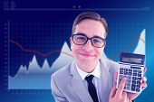 Geeky smiling businessman showing calculator against business interface with graphs and data