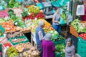 People Shopping At The Vegetable Market Of Funchal, Madeira Island