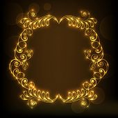 Golden floral design decorated frame on brown background.