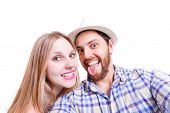 Beautiful Couple taking a selfie photo on white background