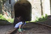 A sad teen depress at a tunnel