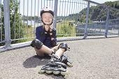 A Little girl in roller skates at a park