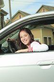 Car driver woman happy showing car keys out window