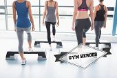 The word gym heroes and aerobics class in session against badge