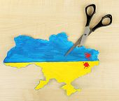 Map of Ukraine with blood and scissors, isolated on white- concept of war in the country