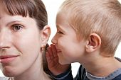stock photo of human ear  - Little human child boy mother ear secrecy whisper - JPG