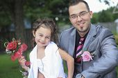 A groom outside with child the wedding day