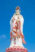 image of goddess  - Statue of the Goddess Guanyin on blue sky - JPG