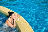 pic of relaxation  - Beautiful happy woman enjoying relax in spa at resort pool - JPG