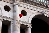 pic of vicenza  - Ancient Palace called BASILICA PALLADIANA with red balloon during the Festival in VICENZA in Italy - JPG