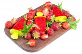 image of strawberry  - strawberries strawberry ice cream on a wooden board strawberries scattered on the board - JPG