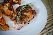 foto of roasted pork  - Pork steak with roasted carrots and dried tomatoes on white plate - JPG