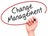 stock photo of change management  - Man hand writing Change Management on visual screen - JPG