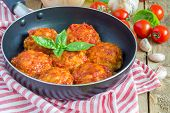 picture of meatball  - Meatballs with tomato sauce in frying pan - JPG