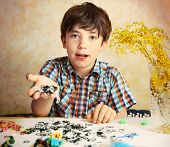 Постер, плакат: Preteen Hansome Boy Show The Result Of His Rainbow Loom Hobby Panda