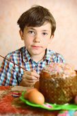 picture of preteen  - preteen handsome boy decorate easter egg and cake  - JPG