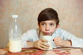 picture of preteens  - cute preteen handsome boy drink milk from mug - JPG